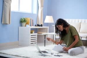 girl working in living room - Titan Business Suites