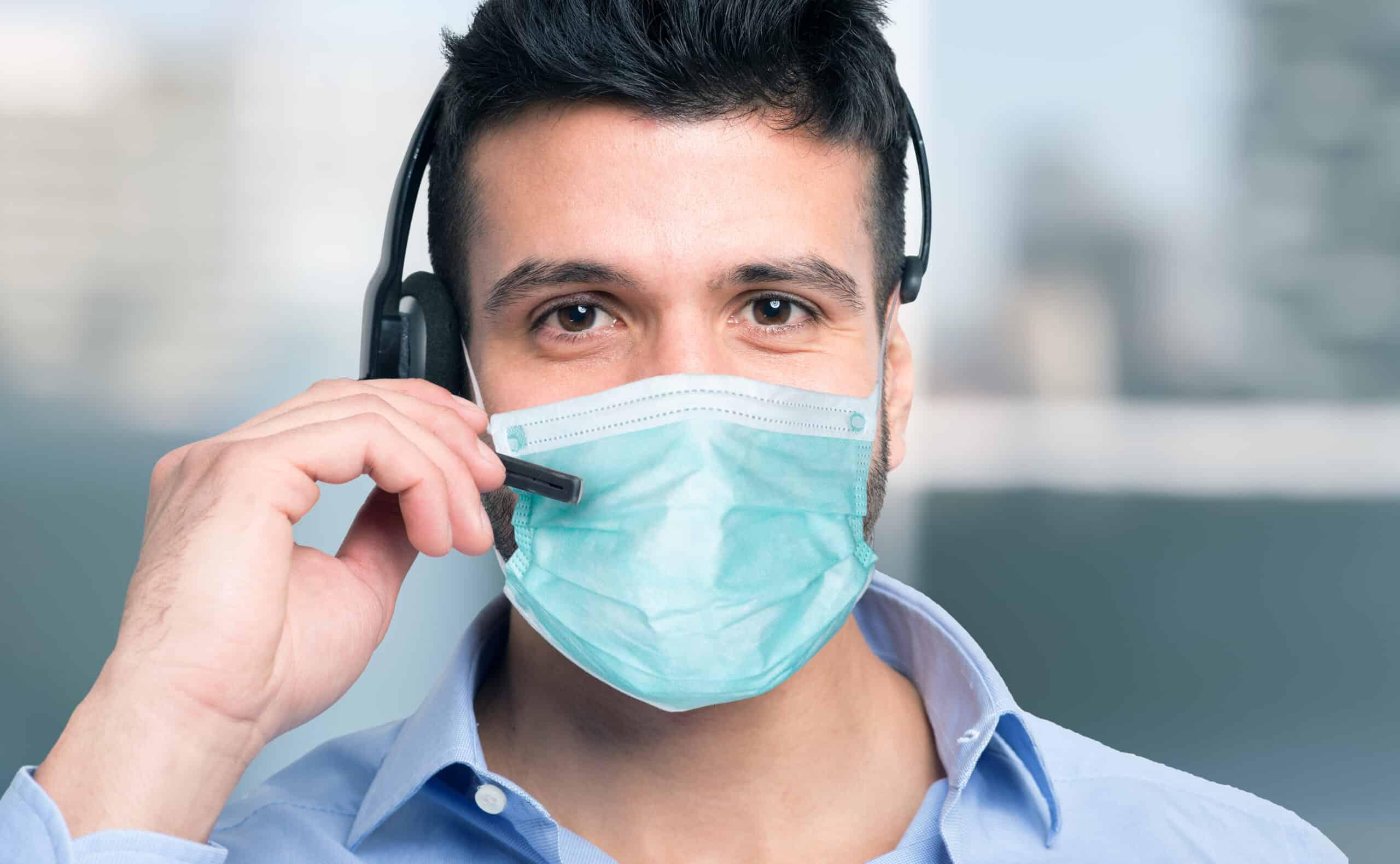 Masked man using his mic headset